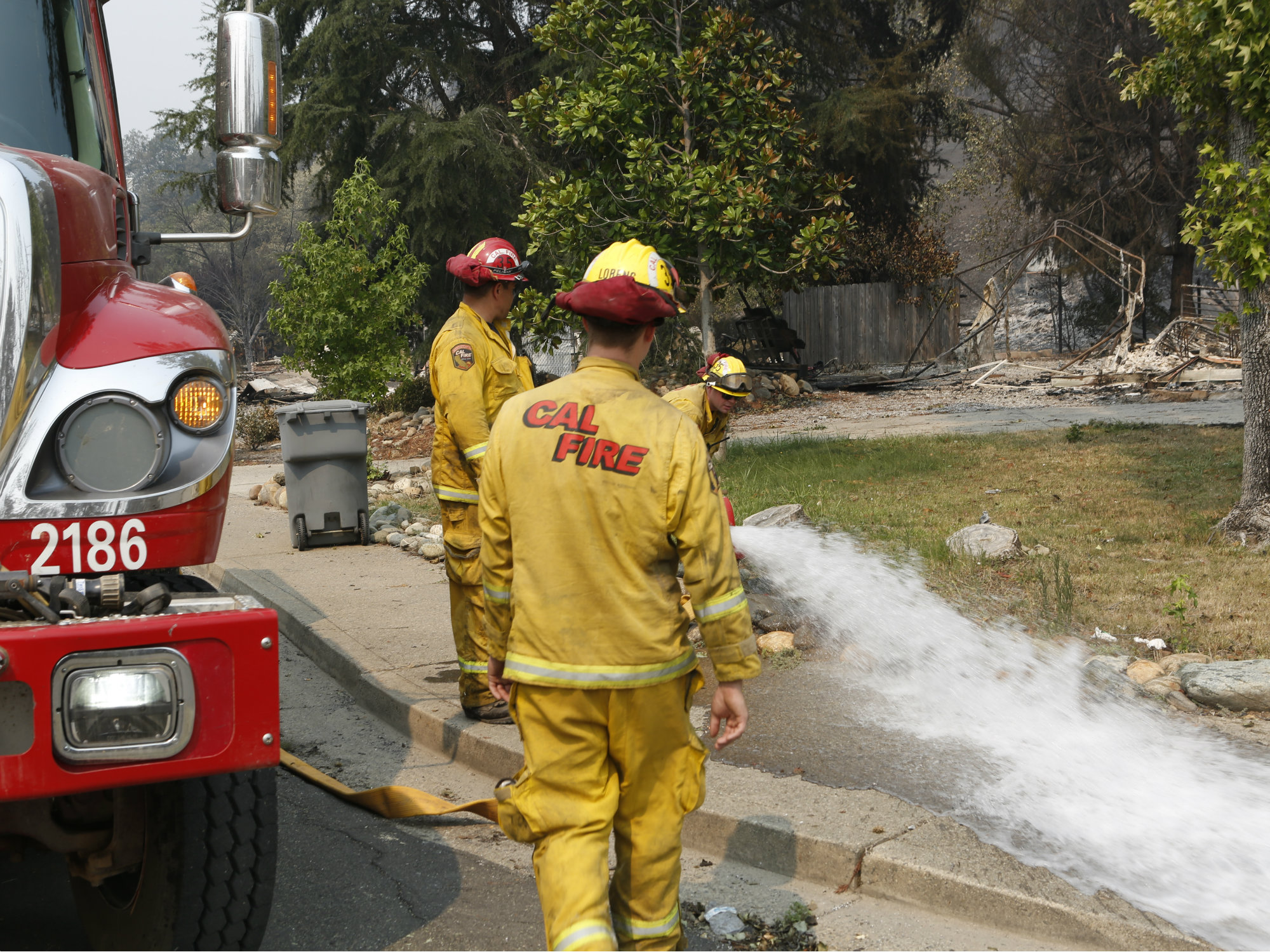 072818Carr Fire Firefighters 7-BJ-p