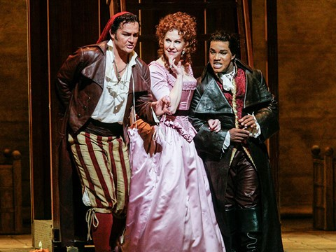 "Russell Braun as Figaro, Joyce DiDonato as Rosina, and Lawrence Brownlee as Count Almaviva in Rossini's ""Il Barbiere di Siviglia."" Photo: Ken Howard/Met Opera"
